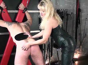 fetish leather mistress punishes slave