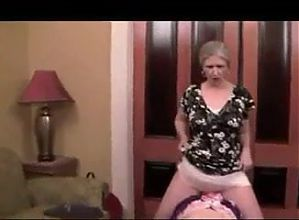 Mature Mistress dominates sissy