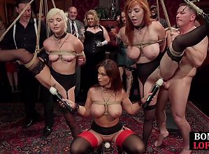 BDSM ginger tied up and toyed in front of group
