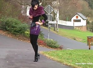 Shiny Catsuit and Fur Collar Walking Outdoors