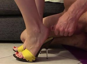 Obedient slave cums in mistress mules